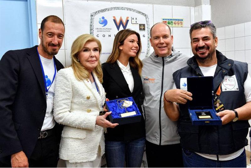 Η κυρία Μαριάννα Β. Βαρδινογιάννη και ο Πρίγκιπας Αλβέρτο του Μονακό με τη δημοσιογράφο του SkySportF1 και τους κυρίους Παπασάββα και Μαστοράκη