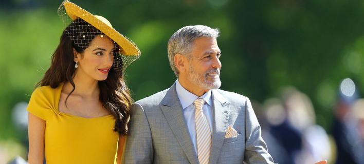 Η Αμάλ Αλαμουντίν με τον Τζιρτζ Κλούνεϊ στον βασιλικό γάμο/Φωτογραφία: AP