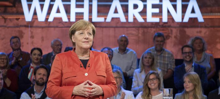 Απλή εμφανίστηκε η Γερμανίδα Καγκελάριος. Φωτογραφία αρχείου: Daniel Reinhardt/dpa via AP