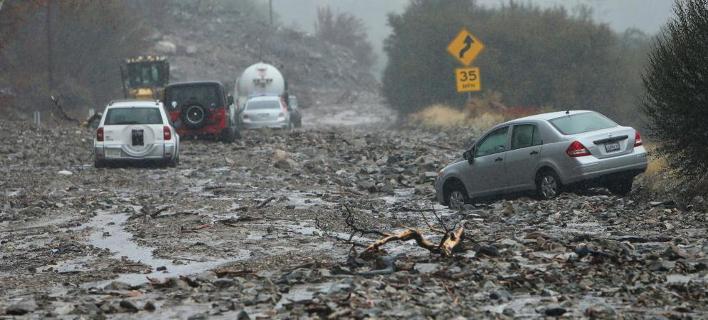 Η νεροποντή ήλθε να αποτελειώσει την καταστροφή στη βόρεια Καλιφόρνια (Φωτογραφία: ΑΡ)