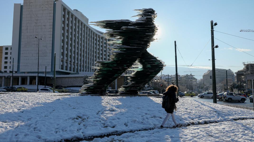 Ο Δρομέας στο Hilton πασπαλισμένος με χιόνι