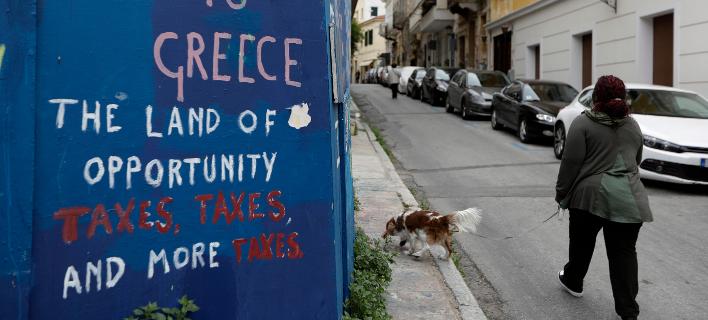 Θλιβερά τα στοιχεία του ΔΝΤ για τα χρέη του ιδιωτικού τομέα -Φωτογραφία: AP Photo/Thanassis Stavrakis