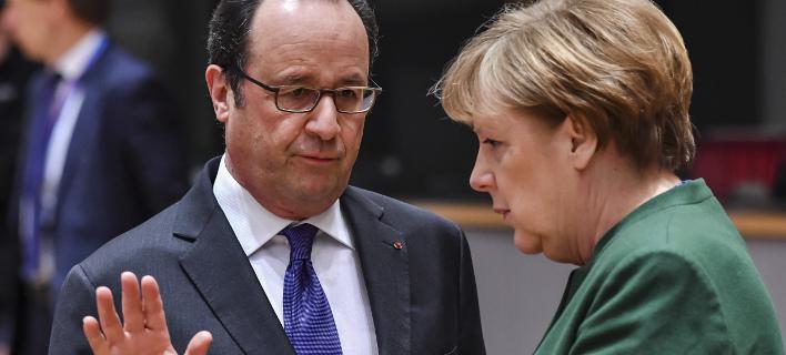 Ο Φρανσουά Ολάντ με την Ανγκελα Μέρκελ/ Φωτογραφία: AP- Geert Vanden Wijngaert