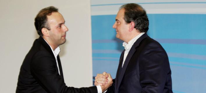 Κώστας Καραμανλής και Γιώργος Παπανικολάου το 2009, όταν ο πρώτος ήταν πρωθυπουργός και ο δεύτερος πρόεδρος της ΟΝΝΕΔ-Φωτογραφία: ΜΟΤΙΟΝΤΕΑΜ/ΚΩΣΤΑΣ ΠΑΠΑΔΟΠΟΥΛΟΣ