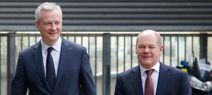 Ο Γάλλος υπουργός Οικονομικών, Μπρούνο Λεμέρ και ο Γερμανός ομόλογός του, Ολαφ Σόλτς/Φωτογραφία: ΑΡ