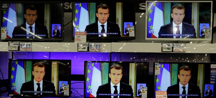 Η Κομισιόν παρακολουθεί στενά τις εξαγγελίες Μακρόν -Φωτογραφία: AP Photo/Claude Paris