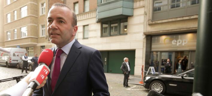 Ο υποψήφιος του ΕΛΚ για την προεδρία της Κομισιόν, Μάνφρεντ Βέμπερ (Φωτογραφία:AP/Olivier Matthys)