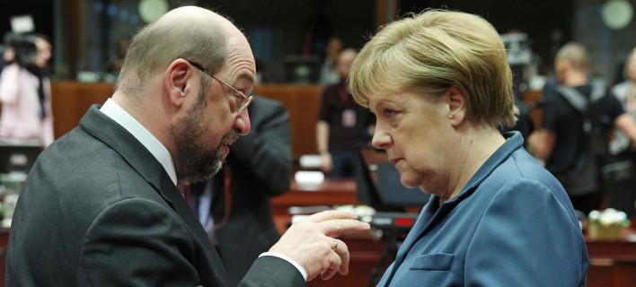 Μάρτιν Σουλτς και Άνγκελα Μέρκελ/ Φωτογραφία: Yves Logghe/ AP