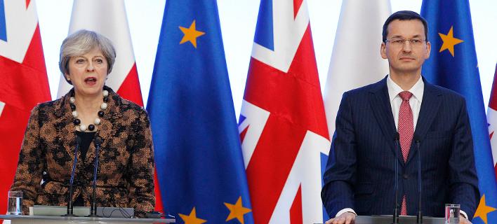 Η Βρετανίδα πρωθυπουργός και ο Πολωνός ομόλογός της, Ματέους Μοραβιέτσκι (Φωτογραφία: ΑΡ)
