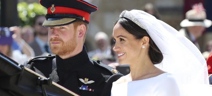 Ο πρίγκιπας Χάρι και η Μέγκαν Μαρκλ στον γάμο /Φωτογραφία: AP