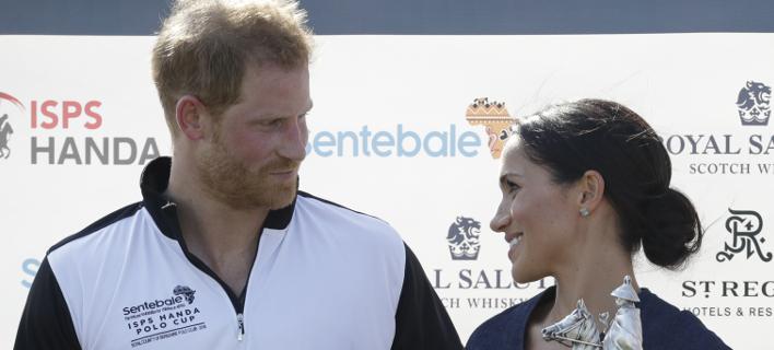Ο πρίγκιπας Χάρι και η Μέγκαν Μαρκλ /Φωτογραφία: AP/Matt Dunham