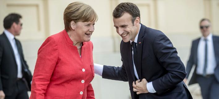 Μέρκελ και Μακρόν θέλουν να συμφωνήσουν μέχρι τον Ιούνιο για τις μεταρρυθμίσεις στην ευρωζώνη