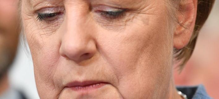 Η Α. Μέρκελ την ημέρα των γερμανικών εκλογών / Φωτογραφία: (Boris Roessler/dpa via AP)