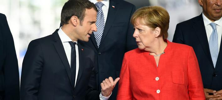Στο Παρίσι για το μεταναστευτικό Μέρκελ, Τζεντιλόνι και Ραχόι / Φωτογραφία: (Eric Vidal/Pool Photo via AP)