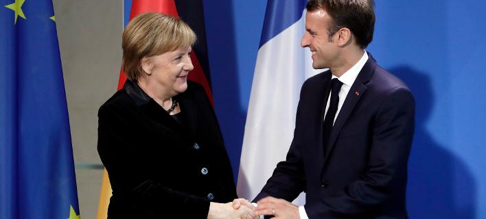 H Γερμανίδα καγκελάριος Μέρκελ και ο Γάλλος πρόεδρος Μακρόν (Φωτογραφία: ΑΡ/Michael Sohn)