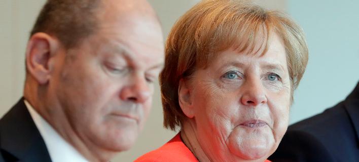 Η καγκελάριος Ανγκελα Μέρκελ και ο υπουργός Οικονομικών, Ολαφ Σολτς/Φωτογραφία: ΑΡ