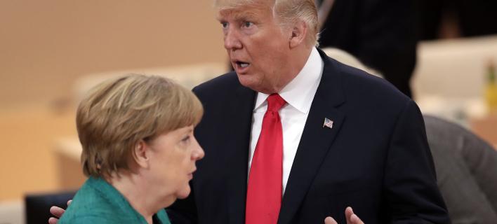 Η Μέρκελ ζητά ψυχραιμία, ο Τραμπ δεν την ακούει (Φωτογραφία: AP/ Michael Sohn)