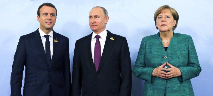 Μακρόν, Πούτιν και Μέρκελ θα συζητήσουν σήμερα για τη Συρία (Φωτογραφία: AP/ Mikhail Klimentyev)