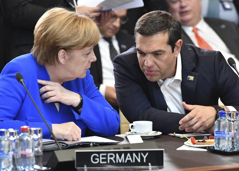 Η Ανγκελα Μέρκελ και ο Αλέξης Τσιπρας/ Φωτογραφία AP images