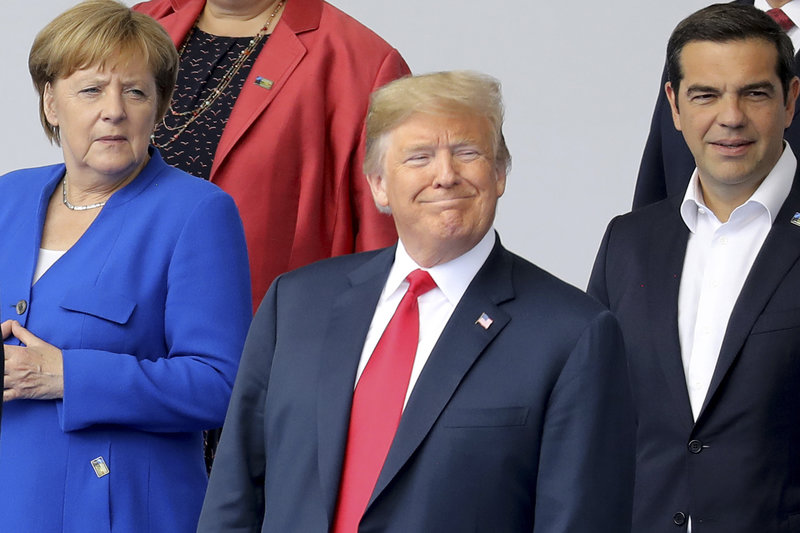 H Άνγκελα Μέρκελ, ο Ντόναλντ Τραμπ και ο Αλέξης Τσίπρας /Φωτογραφία AP images