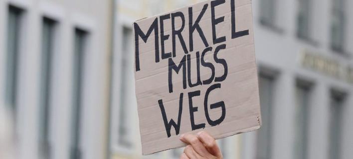 Aποδοκίμασαν τη Μέρκελ στους εορτασμούς για την επέτειο επανένωσης της Γερμανίας