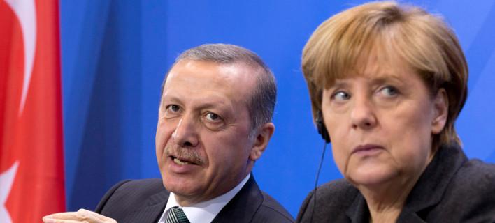 Η Γερμανίδα καγκελάριος Ανγκελα Μέρκελ και ο Τούρκος Πρόεδρος Ρετζέπ Ταγίπ Ερντογάν/ Φωτογραφία: Axel Schmidt/ AP
