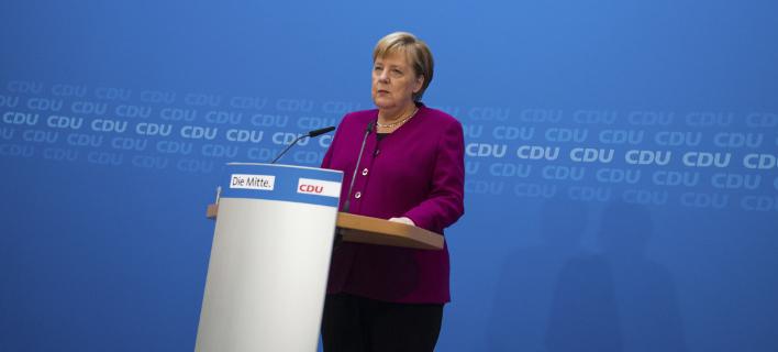 Η Μέρκελ δεν θα παραστεί στη δεξίωση που θα παραθέσει ο Φρανκ-Βάλτερ Σταϊνμάιερ/Φωτογραφία: AP