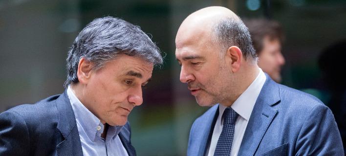 Ο Ευρωπαίος επίτροπος Πιέρ Μοσκοβισί σε παλαιότερη συνάντησή του με τον Ελληνα υπουργό Οικονομικών/Φωτογραφία αρχείου: Eurokinissi