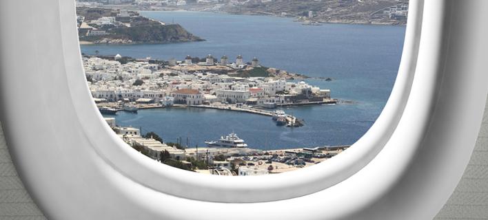 Φωτογραφία: Shutterstock- Θέα από το παράθυρο του αεροπλάνου