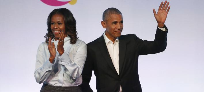 Συμφωνία με το Netflix υπέγραψαν οι Ομπάμα (Φωτογραφία: AP/ Charles Rex Arbogast)