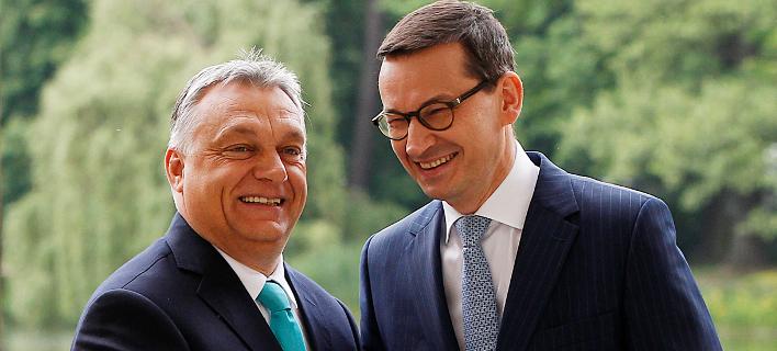 Oι πρωθυπουργοί Ουγγαρίας και Πολωνίας, Βίκτορ Ορμπάν και Ματέους Μοραβιέτσκι (Φωτογραφία αρχείου: ΑΡ)