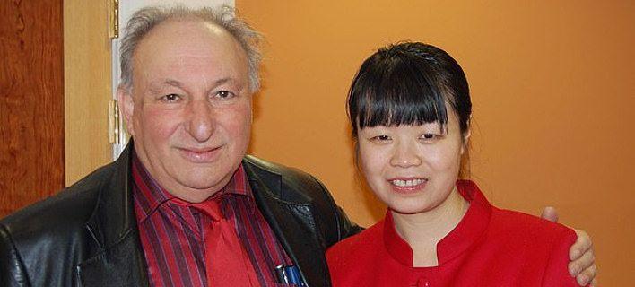 O Ντείβιντ Μπούκμπαϊντερ και η γυναίκα του Γουάνγκ Γι