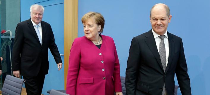 Η Άνγκελα Μέρκελ και ο Ολαφ Σολτς/ Φωτογραφία AP images