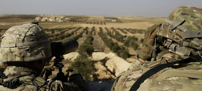Αμερικανοί στρατιώτες σε φυλάκιο στη Μανμπίτζ της βορειοανατολικής Συρίας (Φωτογραφία: ΑΡ)
