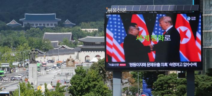 Ντόναλντ Τραμπ & Κιμ Γιονγκ Ουν (Φωτογραφία: AP Photo/Ahn Young-joon)