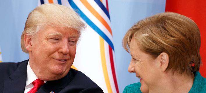 Ο Αμερικανός πρόεδρος Ντόναλντ Τραμπ με την Ανγκελα Μέρκελ σε παλαιότερη συνάντησή τους-Φωτογραφία:AP/Evan Vucci