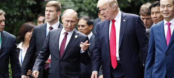 Ο Ντόναλντ Τραμπ και ο Βλαντιμίρ Πούτιν (Φωτογραφία: AP/ Jorge Silva)
