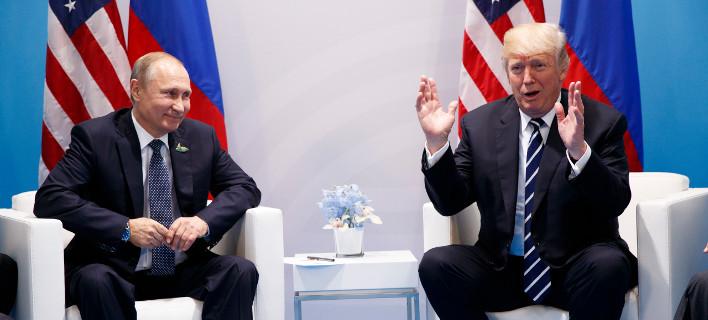 Πούτιν και Τραμπ στη συνάντηση των G20/ Φωτογραφία: Evan Vucci/AP