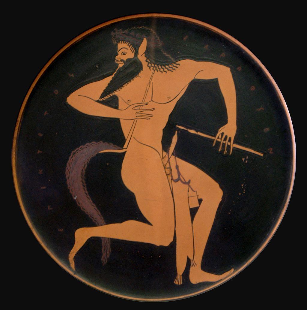 Αττικό ερυθρόμορφο πινάκιο του 520-500 π.Χ. με σάτυρο που κρατά στo  αριστερό χέρι έναν αυλό