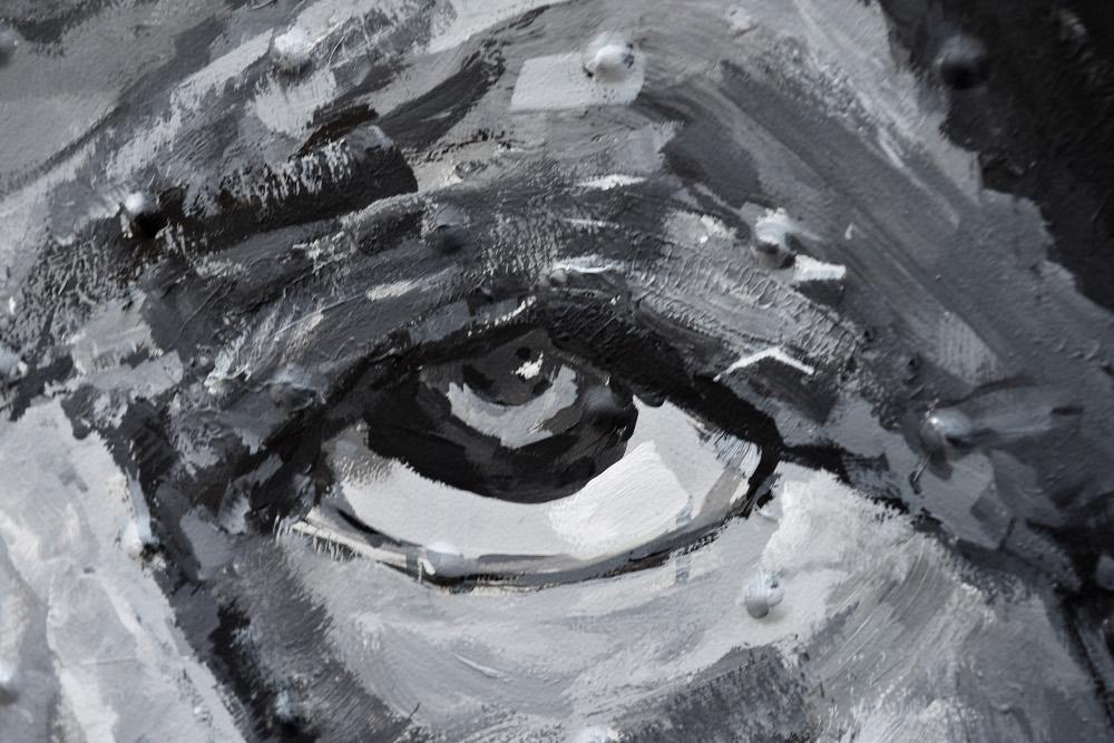Εντυπωσιακές γραμμές από το πινέλο σχηματίζουν το μάτι ενός άνδρα. Δεν είναι καμβάς, είναι λεπτομέρεια από ΚΑΦΑΟ στην ΑΘήνα