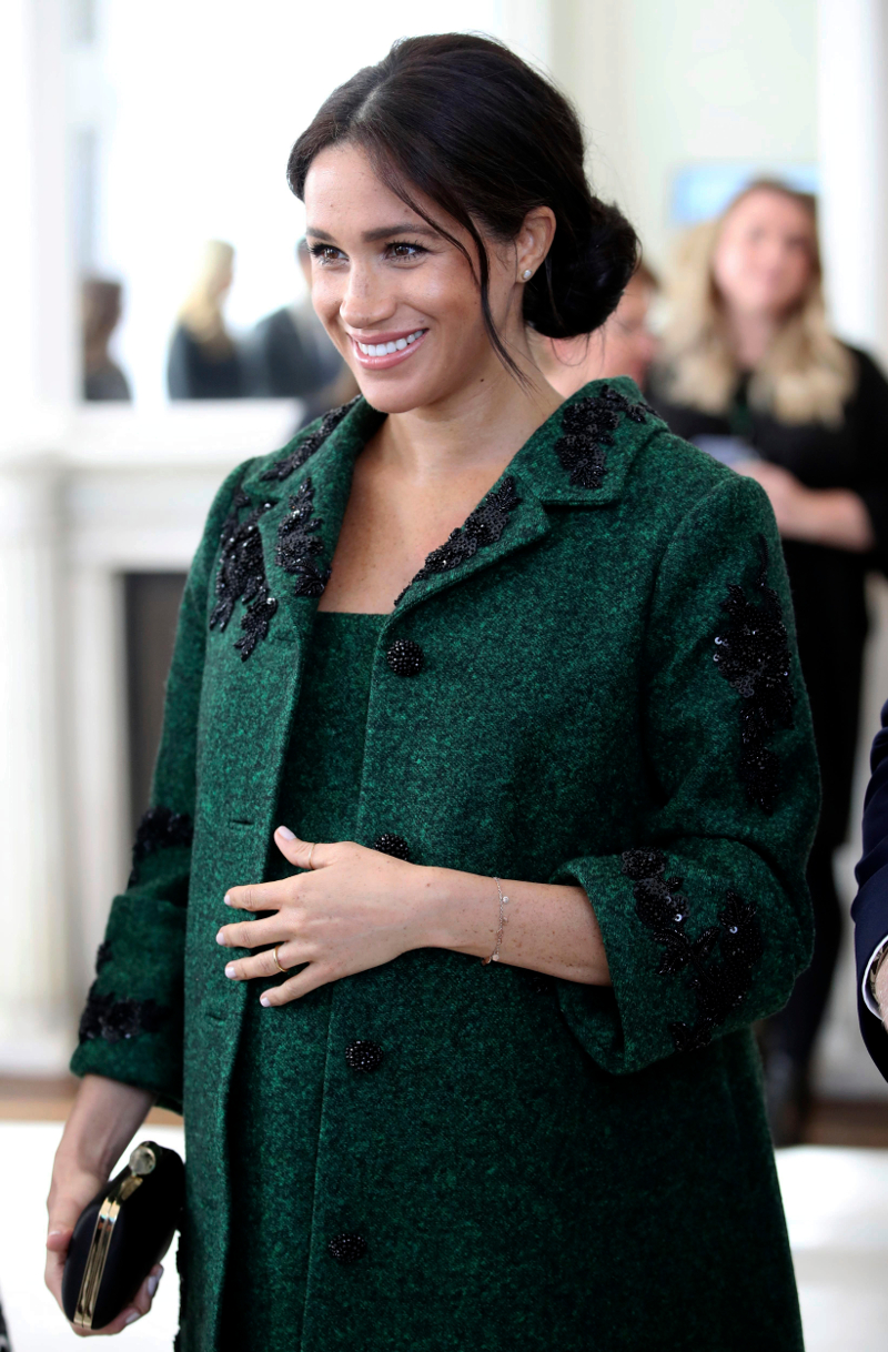 Η Μέγκαν Μαρκλ με πράσινο παλτό και φόρεμα